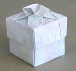 The lid of this box has a design based on the basic tesselation twist.  After forming the design using tesselation techniques the sheet was then treated as a normal square and folded into a basic box shape.