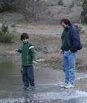 Tristan walking, gingerly, on water.