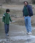 Peter watches while Tristan stands on water.