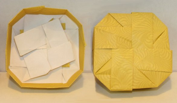 A squashed octagonal box.  Walls of different widths and angles.  Sept. 2006.   Designed and folded by Rosemary LYNDALL WEMM.