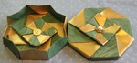 OCTAGONAL GIFT BOX S02  LID: 8 pieces of 10 inch square wallpaper BASE: 8 pieces of 9 7/8 inch square wallpaper. Paper is painted gold on the back. Center buttons secured with button safety pins.  VIEW: Different view of  inside of base and outside (top) of lid.